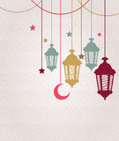 Ramadan Kareem background with hanging lamps and stars Royalty Free Stock Images