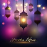 Ramadan Kareem background with hanging lanterns. And glowing stars Stock Photo