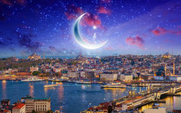 Ramadan Kareem background, night view of Istanbul from Galata to Stock Images
