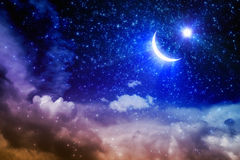 Ramadan Kareem. Background with shining moon and stars above pink clouds, holy month. Elements of this image furnished by NASA nasa.gov stock photo