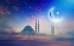 Ramadan Kareem background, Suleymaniye mosque in Istanbul. Ramadan Kareem background with big shiny crescent and stars, sunset view of Suleymaniye mosque in royalty free stock image