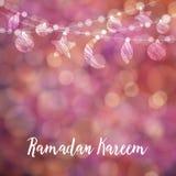 Ramadan Kareem card, invitation. Hanging moon, stars, balls. Festive colorful glitter blurred web background, bokeh lights. Stock Image