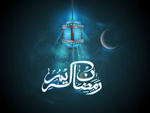 Ramadan Kareem celebration with Arabic text and lamp. Royalty Free Stock Photo