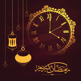 Ramadan Kareem celebration with clock and lanterns. Stock Images