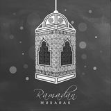 Ramadan Kareem celebration with creative Arabic lamp. Royalty Free Stock Photography