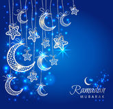 Ramadan Kareem celebration greeting card. Decorated with moons and stars on blue background