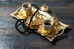 Ramadan kareem Coffee cups golden decorations rosary. Ramadan kareem. Coffee cups, golden decorations and rosary Royalty Free Stock Photography