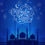 Ramadan Kareem dark blue illustration. Ramadan Kareem illustration, silhouette of mosque in blue colors with white text royalty free illustration
