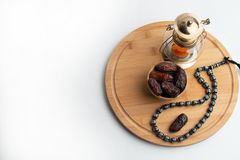 Ramadan Kareem Festival, Dates on wooden bowl with candle lamp and rosary stock photos