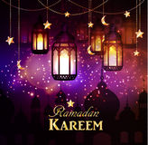 Ramadan Kareem, greeting background. With hanging stars moons and lights Stock Image