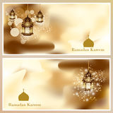 Ramadan Kareem greeting card glowing gold arabic lamp - Translation of text Stock Photos