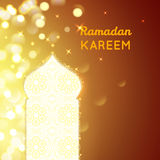 Ramadan Kareem greeting on gold bokeh background Stock Photo