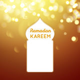 Ramadan Kareem greeting on gold bokeh background Royalty Free Stock Photography