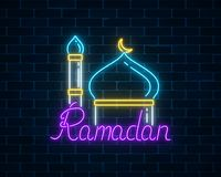 Ramadan kareem greeting text with mosque dome and minaret. Glowing neon banner of ramadan islamic holy month on dark brick wall background. Ramadan kareem Stock Photo