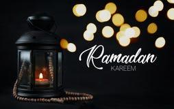 Ramadan Kareem Greeting Typography Beautiful Bokeh. Ramadan Candle Lantern with Wooden Prayer Beads