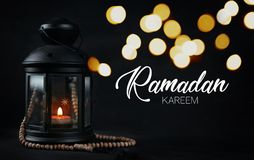 Free Ramadan Kareem Greeting Typography Beautiful Bokeh. Ramadan Candle Lantern With Wooden Prayer Beads Royalty Free Stock Photography - 117036387