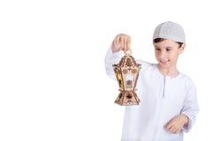 Ramadan Kareem - Happy young kid playing with Ramadan lantern. Ramadan Kareem - Ramadan Greeting Card - Happy young kid playing with Ramadan lantern Stock Photography
