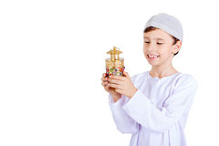 Ramadan Kareem - Happy young kid playing with Ramadan lantern. Isolated on white background Royalty Free Stock Photography