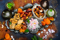 Ramadan Kareem holiday table. With dry fruits, nuts, dates, baklava. Eastern abundance. Copy space royalty free stock images