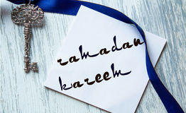 Ramadan kareem lettering for postcards, hand-written on a blue background, can be used for ads, postcards. Ramadan kareem lettering for postcards, hand-written royalty free stock images