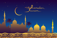 Ramadan kareem message and golden mosque silhouette Stock Images