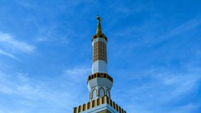 Beautiful white tower mosque in the sunlight. royalty free stock images