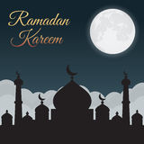 Ramadan Kareem. Night sky with mosque silhouette and moon, clouds. Arabic background Stock Photo