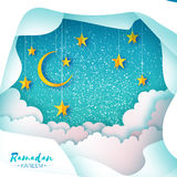 Ramadan Kareem. Paper cut Desert Cave Landscape. Clouds. Hanging Gold stars. Crescent Moon. Night sky. Holy month of Royalty Free Stock Photography