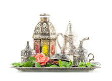Ramadan kareem. Tea table setting withdates, mint leaves and ros. E flower. Oriental hospitality concept stock photo