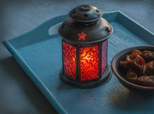 Ramadan lamp and dates still life. Ramadan lamp and dates on a wooden tray