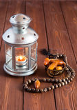 Ramadan lamp and dates still life. On a wooden table