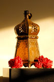 Ramadan lantern. A Ramadan lantern in a home setting with some roses royalty free stock images