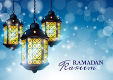 Ramadan Lantern or Fanous with Ramadan Kareem Greetings in a blurry blue Background. 3D Realistic Vector Illustration. Stock Photos