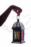 Ramadan Lantern. Young Muslim kid hand holding Ramadan lantern Fanos stock image