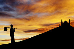 Ramadan muslim heading to mosque. Silhouette of muslim wayfarer walking to the mosque on the hill.  Shot during the month of ramadan Royalty Free Stock Photos