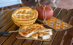 Ramadan pide. Cut and outdoor served with rasary, breadbasket and pottery. photo with shallow depth of field