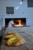 Ramadan pita bread. Bakery in Prizren making Ramadans traditonal bread with creamy cheese and eggs in the middle, baked in a wood oven, a Ramadan speciality Stock Images