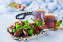 Ramadan ramazan kareem. Traditional arabic tea with mint and dates. For iftar party holidays Royalty Free Stock Photography