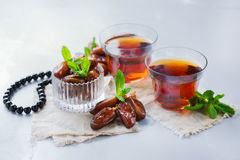 Ramadan ramazan kareem. Traditional arabic tea with mint and dates. For iftar party holidays Royalty Free Stock Photo