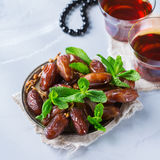 Ramadan ramazan kareem. Traditional arabic tea with mint and dates. For iftar party holidays Royalty Free Stock Image