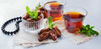 Ramadan ramazan kareem. Traditional arabic tea with mint and dates. For iftar party holidays Stock Photography