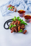 Ramadan ramazan kareem. Traditional arabic tea with mint and dates. For iftar party holidays. Copy space background Royalty Free Stock Photo