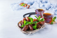 Ramadan ramazan kareem. Traditional arabic tea with mint and dates. For iftar party holidays. Copy space background Royalty Free Stock Image