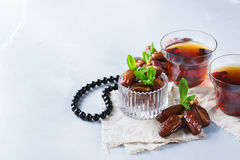 Ramadan ramazan kareem. Traditional arabic tea with mint and dates. For iftar party holidays. Copy space background Stock Photos