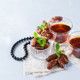 Ramadan ramazan kareem. Traditional arabic tea with mint and dates. For iftar party holidays. Copy space background Stock Image
