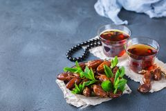 Ramadan ramazan kareem. Traditional arabic tea with mint and dates. For iftar party holidays. Copy space background Stock Images