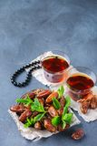 Ramadan ramazan kareem. Traditional arabic tea with mint and dates. For iftar party holidays. Copy space background Stock Photography