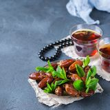 Ramadan ramazan kareem. Traditional arabic tea with mint and dates. For iftar party holidays. Copy space background Royalty Free Stock Images