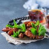 Ramadan ramazan kareem. Traditional arabic tea with mint and dates. For iftar party holidays Royalty Free Stock Photos
