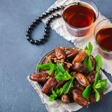 Ramadan ramazan kareem. Traditional arabic tea with mint and dates. For iftar party holidays Stock Image